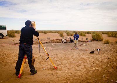 "Students from Bologna University engaged in topographical activities during field excavation at Togolok 1 (Murghab region – Turkmenistan). Italian – Turkmen Archaoelogical Mission in Turkmenistan ""Togolok Project"". Director: Barbara Cerasetti (University of Bologna); Field supervisors: Roberto Arciero, Luca Forni. The Togolol Project was funded by: - University of Bologna - I S M E O — Associazione Internazionale di Studi sul Mediterraneo e l'Oriente - University of Naples ""L'Orientale"" - M A E C I - Ministry of Foreign Affairs and International Cooperation."