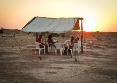 "Members of the team resting at the base camp at sunset (Murghab region – Turkmenistan) Italian – Turkmen Archaoelogical Mission in Turkmenistan ""Togolok Project"". Director: Barbara Cerasetti (University of Bologna); Field supervisors: Roberto Arciero, Luca Forni. The Togolol Project was funded by: - University of Bologna - I S M E O — Associazione Internazionale di Studi sul Mediterraneo e l'Oriente - University of Naples ""L'Orientale"" - M A E C I - Ministry of Foreign Affairs and International Cooperation."